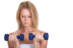 Sporty woman with a dumbbell Royalty Free Stock Photography