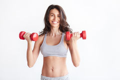 Sporty woman with dumbbells Royalty Free Stock Photo