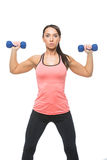 Sporty woman with dumbbells Stock Photo