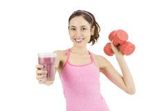 Sporty woman with dumbbells drinking smoothie Royalty Free Stock Photography