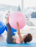 Sporty woman with exercise ball in fitness studio Stock Image