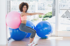 Sporty woman with exercise ball in fitness studio Royalty Free Stock Photography