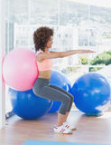 Sporty woman with exercise ball in fitness studio Royalty Free Stock Photo