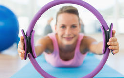 Sporty woman with exercise ring in fitness studio Stock Photos