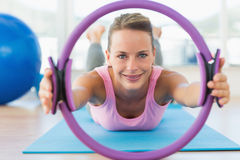 Sporty woman with exercise ring in fitness studio Stock Photo