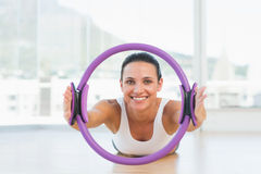 Sporty woman with exercise ring in fitness studio Royalty Free Stock Photography