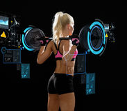 Sporty woman exercising with barbell from back Royalty Free Stock Photos