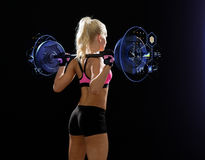 Sporty woman exercising with barbell from back. Fitness, sport and dieting concept - sporty woman exercising with barbell from back Royalty Free Stock Photo