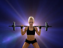 Sporty woman exercising with barbell Stock Images