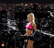 Sporty woman exercising with barbell Royalty Free Stock Photo