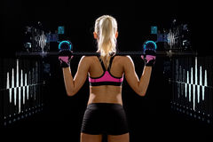 Sporty woman exercising with barbell Royalty Free Stock Images