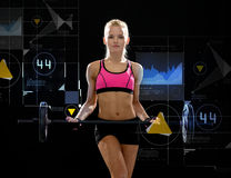 Sporty woman exercising with barbell. Fitness, sport and dieting concept - sporty woman exercising with barbell Royalty Free Stock Photos