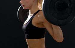 Sporty woman exercising with barbell Stock Photos