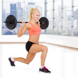 Sporty woman exercising with barbell Stock Photography