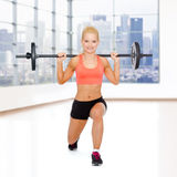 Sporty woman exercising with barbell Royalty Free Stock Photography