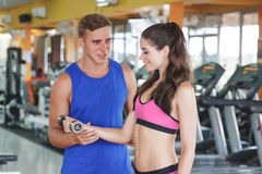 Sporty woman exercising with her instructor Royalty Free Stock Photo
