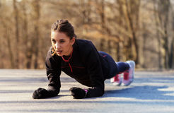 Sporty woman exercising Stock Image