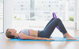Sporty woman with exercising ring in fitness studio Royalty Free Stock Photo