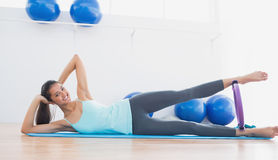 Sporty woman with exercising ring in fitness studio Royalty Free Stock Photography