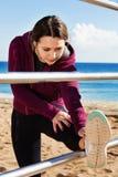 Sporty woman exercising at sea beach Stock Photo