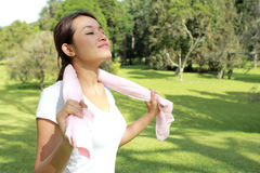 Sporty woman feel relax under the sunshine at park with fresh ai Royalty Free Stock Images