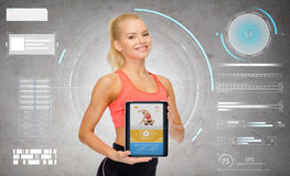 Sporty woman with fitness application on tablet pc royalty free stock photography