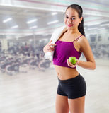 Sporty woman at fitness club Stock Photography