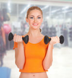 Sporty woman at fitness club Royalty Free Stock Photography
