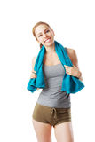 Sporty woman after fitness workout with blue towel. Isolated on white Stock Image