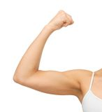 Sporty woman flexing her biceps Royalty Free Stock Photography