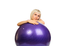 Sporty woman with flexy ball Stock Photo