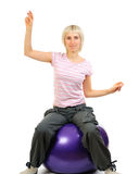 Sporty woman with flexy ball Stock Photography