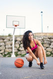 Sporty woman getting ready for basket game Stock Images