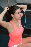 Sporty woman getting ready for exercising Royalty Free Stock Images