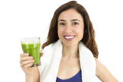 Sporty woman with green smoothie Royalty Free Stock Photos