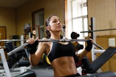 Sporty woman in the gym. Stock Images