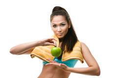 Sporty woman hands green apple Royalty Free Stock Photos