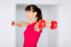 Sporty woman hands with light red dumbbells Stock Photography
