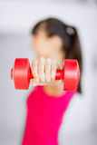Sporty woman hands with light red dumbbells Stock Images