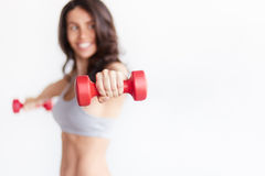 Sporty woman hands with light red dumbbells Royalty Free Stock Photo