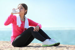 Sporty woman have a break Royalty Free Stock Image