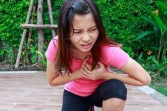 Sporty woman having heart attack - Angina Pectoris, Myocardial I. Nfarction royalty free stock photo