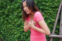 Sporty woman having heart attack - Angina Pectoris, Myocardial I. Nfarction royalty free stock photos