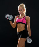Sporty woman with heavy steel dumbbells Stock Photo
