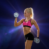 Sporty woman with heavy steel dumbbells Royalty Free Stock Photography