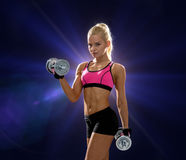 Sporty woman with heavy steel dumbbells Stock Images