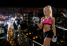 Sporty woman with heavy steel dumbbells Royalty Free Stock Image