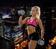 Sporty woman with heavy steel dumbbells Stock Image