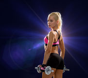Sporty woman with heavy steel dumbbells Royalty Free Stock Photo