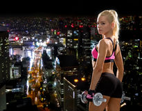 Sporty woman with heavy steel dumbbells Stock Photos